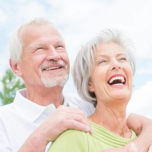 Senior Couple Looking at Sky - Laughing and in Love