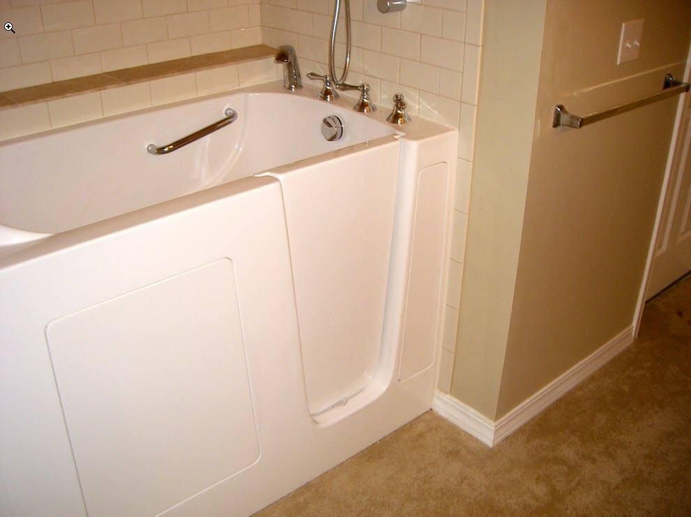 Walk in tub installed in a residential bathroom
